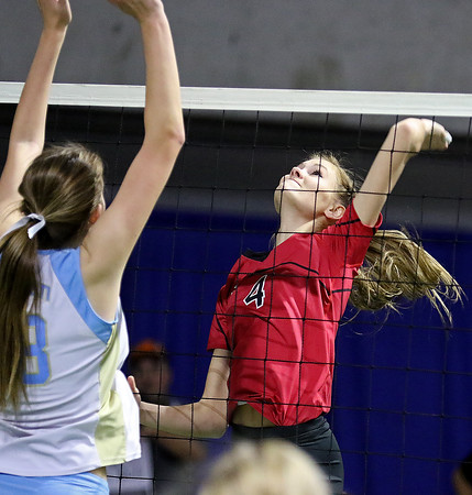 Brad Davis/The Register-Herald<br /> PikeView's Madison May winds up to spike the ball as Oak Glen's Alexis Swan tries to block during Class AA State Volleyball Tournament action Friday afternoon at the Charleston Civic Center.