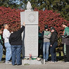 Rick Barbero/The Register-Herald<br /> Visitors of the monument at Spring Hill Cemetary for the Marshall University Football team that killed 45 years ago in a plane crash.