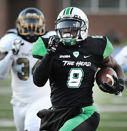 Rick Barbero/The Register-Herald<br /> Remi Watson, of Marshall, breaks away for a touchdown against FIU during game at Joan C. Edwards Stadium in Huntington Saturday evening.