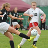 Rick Barbero/The Register-Herald<br /> Meghanie Hawthorne, left, of Weir, kicks the ball away from Alexis O'Dell, of Pikeview, during the class AA/A semi-final match of the State Soccer Tournament held at the YMCA soccer complex in Beckley Friday morning.
