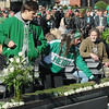 Rick Barbero/The Register-Herald<br /> White roses being placed during Marshall University annual fountain ceremony at the Memorial Student Center Plaza Saturday morning honoring the 45th anniversary of the crash of Southern Airways Flight 932—a chartered airliner carrying the 1970 Marshall Football team that killed all 75 passengers and crew on board. The fountain, made of 75 upward-pointing rods to represent the victims, is turned off every year at the ceremony and remains off until spring practice begins for the following season. In all, 37 players, eight coaches, 25 fans and five crew members were killed in what stands as one of the worst tragedies in collegiate sports history.