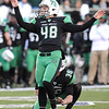 Rick Barbero/The Register-Herald<br /> Nick Smith, of Marshall, kicks a field goal against FIU during game at Joan C. Edwards Stadium in Huntington Saturday evening.