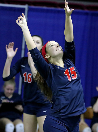 Brad Davis/The Register-Herald<br /> Independence's Madison Holley moves to hit a ball across against Ritchie County during Class AA State Volleyball Tournament action Friday morning at the Charleston Civic Center.