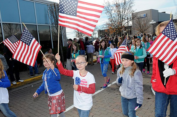 Rick Barbero/The Register-Herald<br /> Girl Scouts marching in the Beckley Veterans Day Parade held in downtown Beckley late Friday morning.