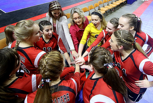 Brad Davis/The Register-Herald<br /> The Crusaders get fired up prior to their game against Magnolia in the Class A State Volleyball Tournament Friday morning at the Charleston Civic Center.