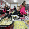Brad Davis/The Register-Herald<br /> Ten-year-old Rhodell resident Dallas Austin, middle, helps himself to a hearty scoop of mashed potatoes during the town's annual Thanksgiving dinner Saturday night at the Rhodell Volunteer Fire Department.