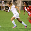 Brad Davis/The Register-Herald<br /> Greenbrier East's Kierston Sutherland moves the ball up the field as Parkersburg's Nilum Patel pursues during the Spartans' 1-0 loss to the Big Reds in State Soccer Tournament action Friday night at the YMCA Paul Cline Memorial Sports Complex.