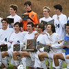 Brad Davis/The Register-Herald<br /> The Fairmont Polar Bears pose for photos with the class AA-A state championship trophy after defeating Charleston Catholic for the title Saturday afternoon at the YMCA Paul Cline Memorial Sports Complex.
