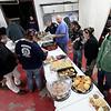 Brad Davis/The Register-Herald<br /> Rhodell community Thanksgiving dinner, Rhodell Volunteer Fire Department, November 21, 2015.