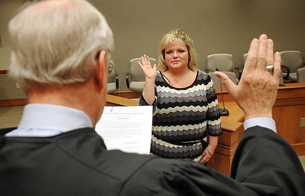 Rick Barbero/The Register-Herald<br /> Raleigh County Circuit Judge Robert Burnside swore in Tracie Ella Claypool as the new adult drug court probation officer Monday morning.