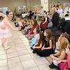 Rick Barbero/The Register-Herald<br /> Lisa West, Sugar Plum Fairy, left, entertain children and parents during the Sugar Plum Fairy Tea Party was held at Lewis Automotive Group, on 100 Appalachian Dr in Beckley Sunday afternoon. Guest enjoyed tea with Clara, the Sugar Plum Fairy and other characters from The Nutcracker. The characters also performed ballet from the show. This was a benefit event for the Heather Zickefoose Scholarship fund to aid talented students to be professional dancers.