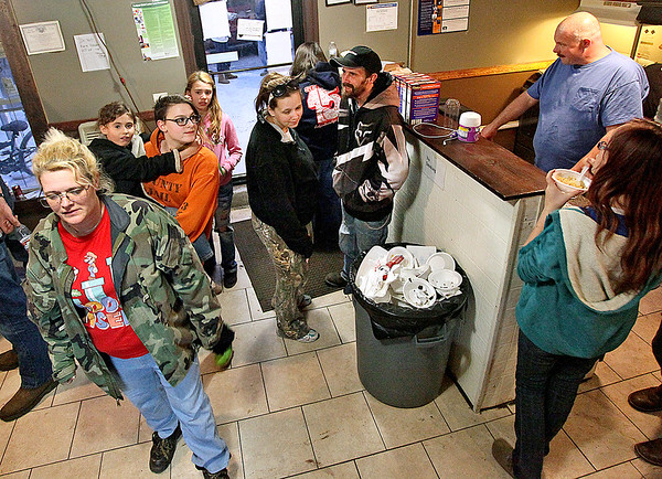 Brad Davis/The Register-Herald<br /> Community members gather at the Rhodell Volunteer Fire Department for the town's annual Thanksgiving dinner Saturday night.