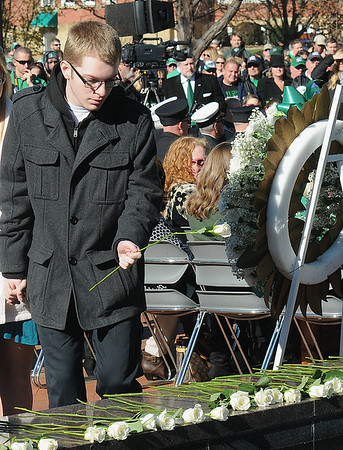 Rick Barbero/The Register-Herald<br /> White roses getting placed during Marshall University  annual fountain ceremony at the Memorial Student Center Plaza Saturday morning honoring the 45th anniversary of the crash of Southern Airways Flight 932—a chartered airliner carrying the 1970 Marshall Football team that killed all 75 passengers and crew on board. The fountain, made of 75 upward-pointing rods to represent the victims, is turned off every year at the ceremony and remains off until spring practice begins for the following season. In all, 37 players, eight coaches, 25 fans and five crew members were killed in what stands as one of the worst tragedies in collegiate sports history.