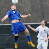 Rick Barbero/The Register-Herald<br /> Max Byron, left, of Morgantown, heads the ball against, Chase Eller, of George Washington, during the class AAA boys semi-final match of the State Soccer Tournament held at the YMCA soccer complex in Beckley Friday morning.