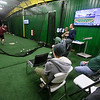 Brad Davis/The Register-Herald<br /> Folks watch the action as Woodrow Wilson's Michael Maiolo bats during Upper Deck indoor hitting league action Sunday afternoon in Beckley.