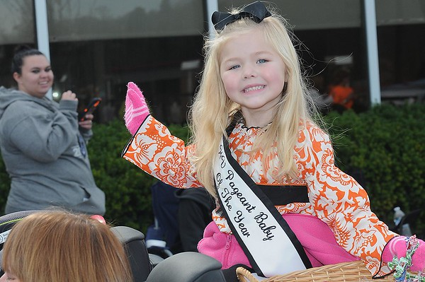Rick Barbero/The Register-Herald<br /> Sophie Grace, WV Pageant Baby of the Year waves to a crowd on Neville Street during the Beckley Veterans Day Parade held in downtown Beckley late Friday morning.
