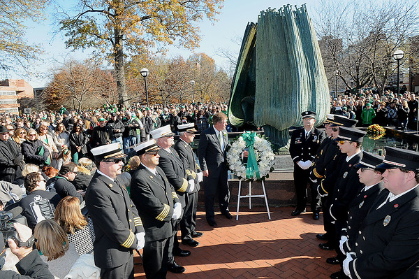 Rick Barbero/The Register-Herald<br /> Mike Hamrick, athletic director, lays a wreath during Marshall University annual fountain ceremony at the Memorial Student Center Plaza Saturday morning honoring the 45th anniversary of the crash of Southern Airways Flight 932—a chartered airliner carrying the 1970 Marshall Football team that killed all 75 passengers and crew on board. The fountain, made of 75 upward-pointing rods to represent the victims, is turned off every year at the ceremony and remains off until spring practice begins for the following season. In all, 37 players, eight coaches, 25 fans and five crew members were killed in what stands as one of the worst tragedies in collegiate sports history.