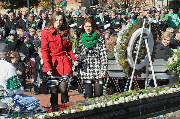 Rick Barbero/The Register-Herald<br /> White roses getting placed down during Marshall University annual fountain ceremony at the Memorial Student Center Plaza Saturday morning honoring the 45th anniversary of the crash of Southern Airways Flight 932—a chartered airliner carrying the 1970 Marshall Football team that killed all 75 passengers and crew on board. The fountain, made of 75 upward-pointing rods to represent the victims, is turned off every year at the ceremony and remains off until spring practice begins for the following season. In all, 37 players, eight coaches, 25 fans and five crew members were killed in what stands as one of the worst tragedies in collegiate sports history.