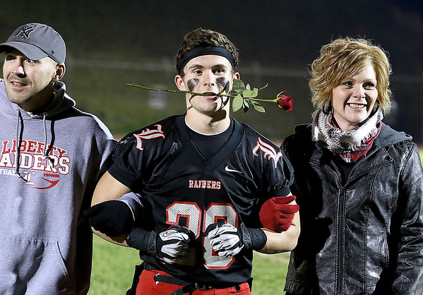 Brad Davis/The Register-Herald<br /> Liberty's Christian Whittaker and family during senior night festivities prior to the Raiders' final home game of the year against Shady Spring Friday night in Glen Daniel.