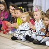 Rick Barbero/The Register-Herald<br /> Children getting entertained during the Sugar Plum Fairy Tea Party was held at Lewis Automotive Group, on 100 Appalachian Dr in Beckley Sunday afternoon. Guest enjoyed tea with Clara, the Sugar Plum Fairy and other characters from The Nutcracker. The characters also performed ballet from the show. This was a benefit event for the Heather Zickefoose Scholarship fund to aid talented students to be professional dancers.