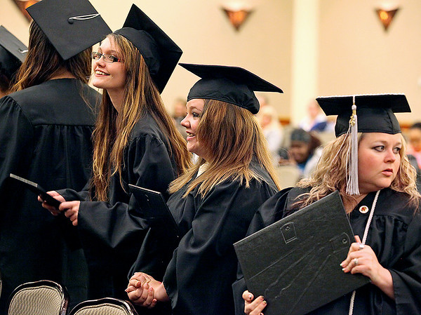 Brad Davis/The Register-Herald<br /> Valley College graduates (from left) Cheyenne Taylor and Hayley Thomas are nearly overcome with joy while Jenny Thomas looks back towards friends and family in attendance after earning their Medical Clinical Assistant diplomas during the school's Fall Commencement ceremony Friday night inside the Tamarack ball rooms.