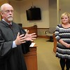 Rick Barbero/The Register-Herald<br /> Raleigh County Circuit Judge Robert Burnside, left, swore in Tracie Ella Claypool as the new adult drug court probation officer Monday morning.
