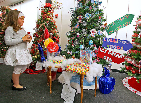 """Brad Davis/The Register-Herald<br /> Seven-year-old Londen Baker stumbles upon the glowing, sugary marvel that is the Beckley Solid Waste Authority's Christmas tree, aptly named """"Candy Land,"""" during the United Way's annual Wonderland of Trees charity auction event Friday night inside the Crossroads Mall."""