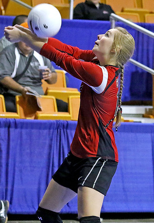 Brad Davis/The Register-Herald<br /> Greater Beckley Christian's Shaedyn Housh returns a serve against Magnolia during Class A State Volleyball Tournament action Friday afternoon at the Charleston Civic Center.