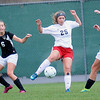 Rick Barbero/The Register-Herald<br /> Kyndall Baker, 25, of Pikeview, center, tries to kick the ball away from two Weir players during the class AA/A semi-final match of the State Soccer Tournament held at the YMCA soccer complex in Beckley Friday morning.
