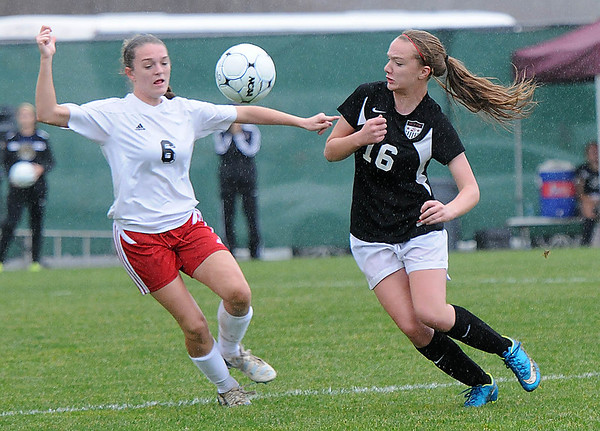 Rick Barbero/The Register-Herald<br /> Kari Shrewsbury, left, of Pikeview, and Mackenzie Hollaway, of Weir, during the class AA/A semi-final match of the State Soccer Tournament held at the YMCA soccer complex in Beckley Friday morning.