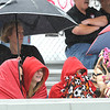 Rick Barbero/The Register-Herald<br /> Weir fans trying to stay dry during the class AA/A semi-final match of the State Soccer Tournament held at the YMCA soccer complex in Beckley Friday morning.
