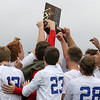 Brad Davis/The Register-Herald<br /> The Morgantown Mohigans hoist the class AAA state championship trophy after defeating Washington for the title Saturday afternoon at the YMCA Paul Cline Memorial Sports Complex.