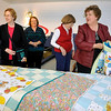 Brad Davis/The Register-Herald<br /> Quilters from the Sew Sew Sisters and Hands All Around organize and divide up several special baby quilts before being donated to Raleigh General Hospital and Birthright of Beckley Wednesday afternoon at the Beckley-Raleigh County Convention Center. From left are Mary Ann Eccles, Birthright of Beckley's Marcia Evans, Hands All Around's Nancy Cameron and acting chair of the Appalachian Treasures Quilt Show Judith Bragg.