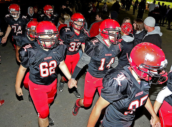 Brad Davis/The Register-Herald<br /> The Raiders take the field prior to Liberty's final home game against Shady Spring Friday night in Glen Daniel.