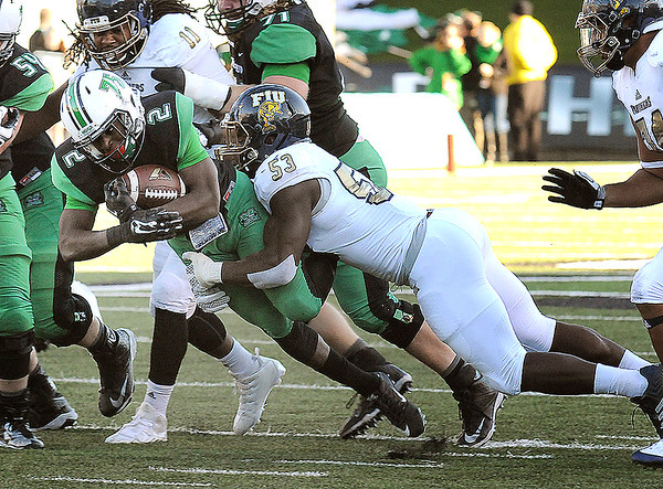 Rick Barbero/The Register-Herald<br /> Hyleck Foster, left, of Marshall, Anthony Wint, of FIU, during game at Joan C. Edwards Stadium in Huntington Saturday evening.