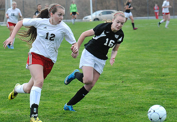 Rick Barbero/The Register-Herald<br /> Alexis O'Dell, left, of Pikeview, getting defended by Mackenzie Hollway, of Weir, during the class AA/A semi-final match of the State Soccer Tournament held at the YMCA soccer complex in Beckley Friday morning.