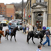 Brad Davis/The Register-Herald<br /> A unique funeral procession featuring a riderless horse tribute (seen at far right) takes place through downtown Mullens Saturday morning. It was in memory of 64-year-old Delmer Shrewsbury, who passed away November 24th after a battle with pancreatic cancer. He was a lifelong Mullens resident, loved horses and was well-known throughout town as a proud cowboy, which is part of the reason for the tribute. He was also a U.S. Army veteran, serving two tours in Korea over a six-year career. Believed to originate back to the days of Ghengis Khan, the riderless horse tribute has generally served as a military tribute. The boots in the riderless horse's stirrups are turned backwards, symbolizing a leader's last look back at his troops. It was proper fit for Shrewsbury as horseman too, as a pair of his reversed boots and one of his old hats symbolized a last look back at his immediate family, which rides behind him at left.