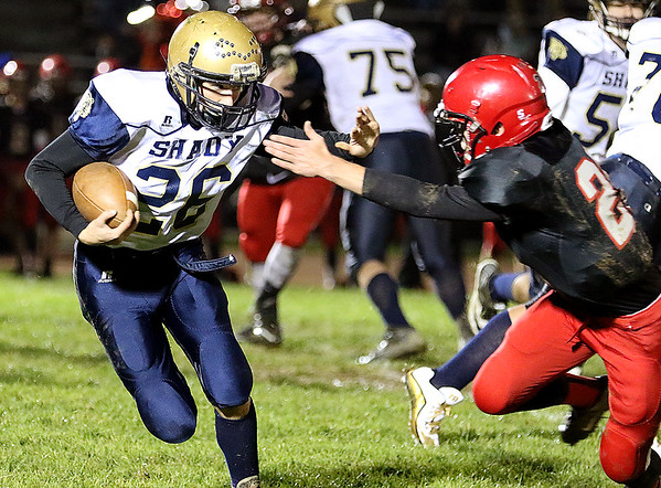 Brad Davis/The Register-Herald<br /> Shady Spring's Chase DeMoss carries the ball against Liberty Friday night in Glen Daniel.