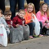 Rick Barbero/The Register-Herald<br /> Children waiting to grab some candy during the Beckley Veterans Day Parade held in downtown Beckley late Friday morning.