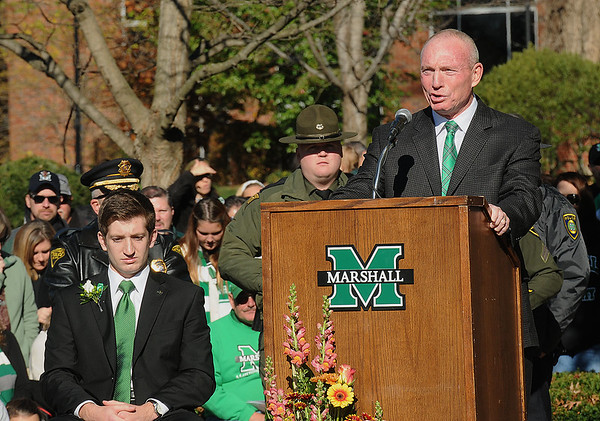 Rick Barbero/The Register-Herald<br /> Doc Holiday, head football coach, spoke during Marshall University annual fountain ceremony at the Memorial Student Center Plaza Saturday morning honoring the 45th anniversary of the crash of Southern Airways Flight 932—a chartered airliner carrying the 1970 Marshall Football team that killed all 75 passengers and crew on board. The fountain, made of 75 upward-pointing rods to represent the victims, is turned off every year at the ceremony and remains off until spring practice begins for the following season. In all, 37 players, eight coaches, 25 fans and five crew members were killed in what stands as one of the worst tragedies in collegiate sports history.