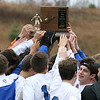 Brad Davis/The Register-Herald<br /> The Fairmont Polar Bears hoist the class AA-A state championship trophy after defeating Charleston Catholic for the title Saturday afternoon at the YMCA Paul Cline Memorial Sports Complex.
