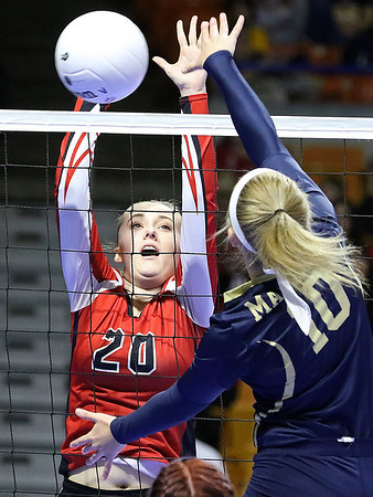 Brad Davis/The Register-Herald<br /> Greater Beckley Christian's Chandler Hall, left, blocks a spike attempt by Magnolia's Taylor Ludewig during Class A State Volleyball Tournament action Friday afternoon at the Charleston Civic Center.