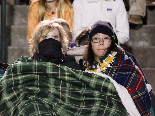 Chris Jackson/The Register-Herald<br /> Greenbrier East cheerleading coaches LeAnne Hobbs and Joyce Byers bundle up during their football game against Princeton Friday in Fairlea.