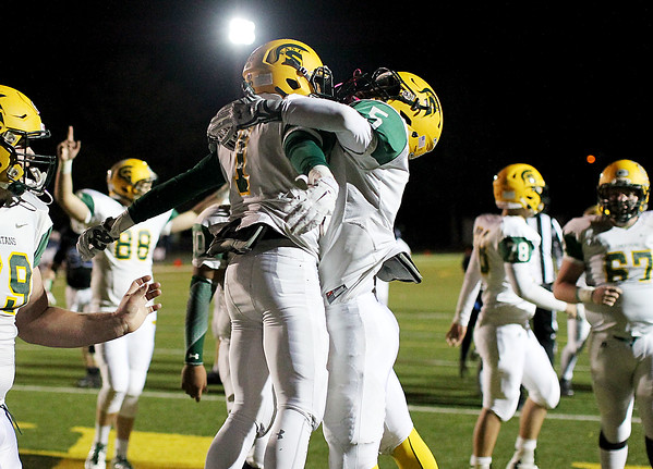 Chris Jackson/The Register-Herald<br /> Greenbrier East's Shakem Atkinson (7) is congratulated by <br /> William Honaker (5) after falling on a fumble in the end zone for a touchdown in the second quarter of their football game against Princeton Friday in Fairlea.