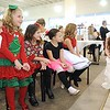 Rick Barbero/The Register-Herald<br /> Jenna Meador, as Clara, right, speaks with, Natalie Craddock, left, Camryn Harris, Ava Lilly, Holly Jones and Paetyn Kieth, during the Sugar Plum Fairy Tea Party was held at Lewis Automotive Group, on 100 Appalachian Dr in Beckley Sunday afternoon. Guest enjoyed tea with Clara, the Sugar Plum Fairy and other characters from The Nutcracker. The characters also performed ballet from the show. This was a benefit event for the Heather Zickefoose Scholarship fund to aid talented students to be professional dancers.