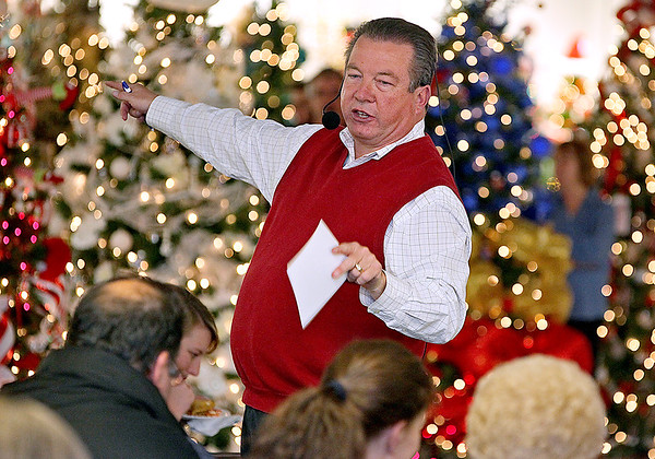 Brad Davis/The Register-Herald<br /> Auctioneer Richard Jarrell takes bids from the huge crowd in attendance during the United Way's annual Wonderland of Trees charity auction event Friday night inside the Crossroads Mall.
