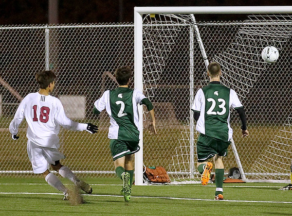 Brad Davis/The Register-Herald<br /> Woodrow Wilson midfielder Keegan Rose (#18) scores a second half, one-touch goal off a direct kick from teammate Brandon Chandler Thursday night at the YMCA Paul Cline Memorial Sports Complex.