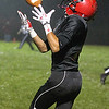 Brad Davis/The Register-Herald<br /> Liberty receiver Deontae Acord hauls in quarterback Hunter Wright's long touchdown pass during the first quarter of a soggy contest with Princeton Friday night in Glen Daniel.