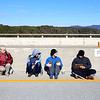Chris Jackson/The Register-Herald<br /> BASE jumpers and attendants enjoy the 2015 Bridge Day event in Fayetteville on Saturday.