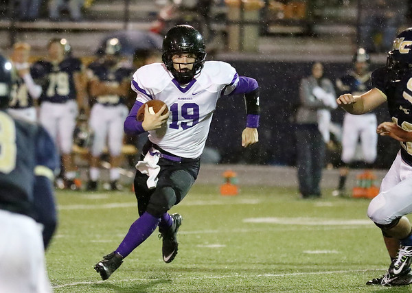 Chris Jackson/The Register-Herald<br /> James Monroe's quarterback Evan Beasley looks to run <br /> during their football game against Nicholas County in Summersville  on Friday, Oct. 2.